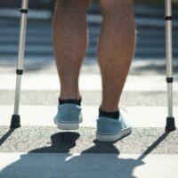 legs crossing crosswalk in city